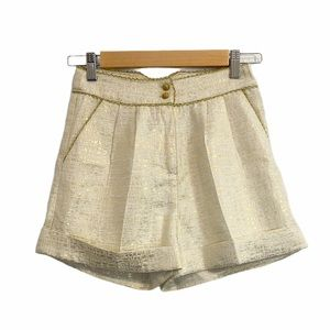 River Island front pleated gold jacquard shorts